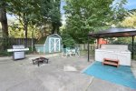 Wonderful patio area with fire pit, outdoor dining, bbq grill, and hot tub