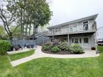 Shared patio with fire pit, outdoor furniture, and a grill