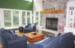 Comfortable living with seasonal fireplace and soaring ceilings