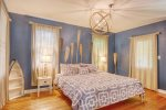 Master bedroom with a king size bed and ensuite