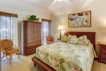 Master bedroom with comfortable queen bed and flat screen tv