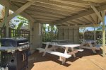 Shaded picnic area with tables