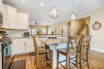 The formal dining room offers comfortable and well-lit seating for 6 guests.