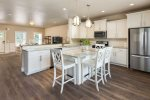 The contemporary full service kitchen, features eat-in island with seating for 6 guests.