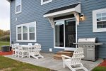 The Beachcomber Cottage`s dining room patio doors connect the main living space with the outdoor living space, making the BBQ grill convenient and accessible.
