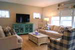 The gorgeously decorated living room is well-lit and comfortable for large groups.