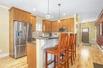 The spacious living room has ample seating, flat screen TV, and gas fireplace.