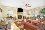 The large back deck with gas grill and outdoor dining space make entertaining groups fun and easy