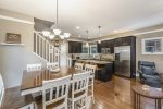 The kitchen, formal dining room, and dine-in island are open concept and equipped with new, stainless appliances.