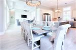 Dining Room Table Comfortably Seats 10-12 Guests, Seamlessly Flows Into Kitchen Area