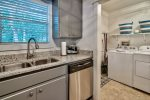 laundry area located just off the upgraded kitchen allows for ease of access