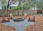 Back of Home Features A Fire Pit and Cornhole
