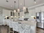 Luxurious chefs kitchen with stainless steal appliance, breakfast bar, and a dinning room