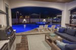 Large Private Gated Pool Area Complete with Putting Green, Outdoor Porch and Big Screen TV