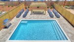 Large pool with spacious deck, gas grill plenty of loungers and outdoor dining completes your bit of beach oasis