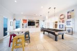 Pristine White Tiled Floor, Pool Table and Modern Coastal Accents