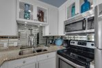 Luxury Kitchen feat. granite counter tops and stainless steel appliances