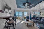 Beautifully decorated living room feat. large flat screen TV and ocean views