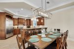 Mediterranean Feels with Open Concept Floor Plan, features Oversized Couches and Chairs, Flat Screen TV and Seamless Dining and Kitchen Area Flow