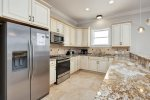Well Appointed and Stocked Kitchen feat. Granite Countertops and Stainless Steel Appliances