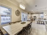 Upgraded Kitchen with Breakfast Bar Seating, Stainless Steel Appliances and Direct Access to the Pool Deck
