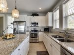 Bright White Kitchen with Shaker Style Cabinets and Granite Counter Tops