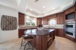 Second Floor Kitchen with Updated Stainless Steel Appliances and Room to Cook with the Whole Family