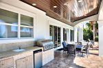 Outdoor Summer Kitchen With Plenty of Seating