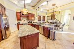 First Floor Gourmet Kitchen with Breakfast Bar and Stainless Steel Appliances