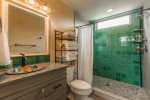 Downstairs bathroom. Clawfoot tub / shower combo, Mexican tiles and sink.