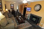 Living room with a wall mounted 40 inch flat screen HDTV and decorative fire place