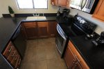 Kitchen with glass cook stop stove