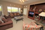 Spacious bright and open living room with a flat screen TV