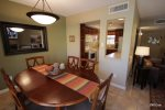 Dining is open to the kitchen and the living room
