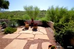 Flagstone seating area around the chiminea