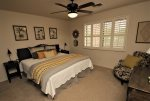 Guest bedroom off of the game room offers a king bed