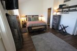 Master suite offers a queen bed and en suite