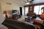 Spacious living room with flat screen TV and patio access