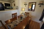 Dining is open to kitchen and living areas