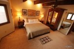 Large master suite with king bed and mountain views