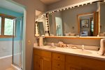The master bathroom has a lovely soaking tub and a very large vanity