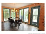 Eat a home cooked meal surrounded by floor to ceiling windows with views of the forest