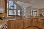 The spacious, fully equipped kitchen has everything you need to whip up a home cooked meal