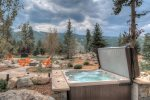 Stargaze while relaxing in your private hot tub with unbeatable views.