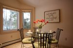 Enjoy the cozy breakfast nook with sweeping views of the Keystone River Golf Course.