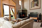 A gas fireplace offers a cozy feel after spending a day in the mountains