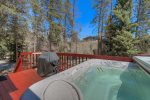 The private hot tub overlooks the bike path and Ten Mile Creek