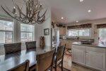 The kitchen is spacious offering beautiful views of Ten Mile Creek