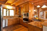 Spacious kitchen equipped with modern appliances and basic spices
