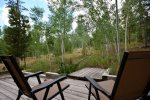 Step into nature and listen to the beautiful sounds from your private deck